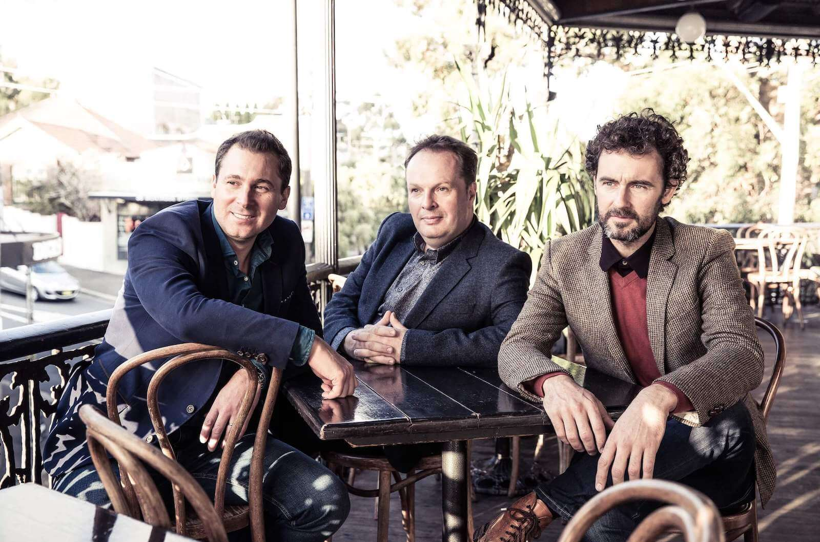 The three members of The Celtic Tenors on a sunny day on a Cafe Patio