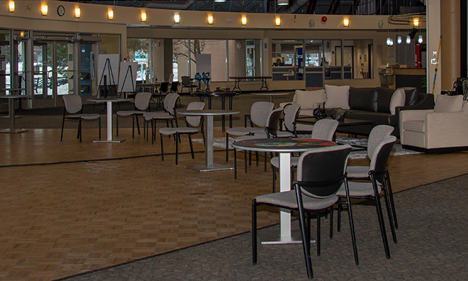 Cafe set-up with socially distanced tables and chairs as well as our designQ lounge with lounge style seating.