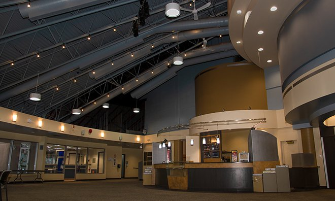 Lobby picture showing the vaulted ceiling and concession area.
